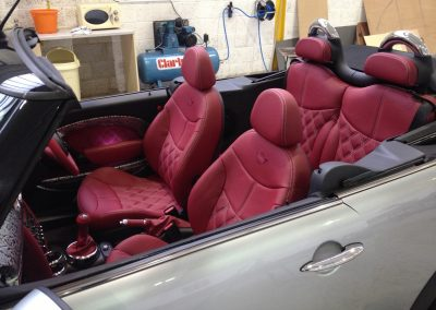03-mini-red-leather-seats-twin-diamond-stitch-embroidered-logos