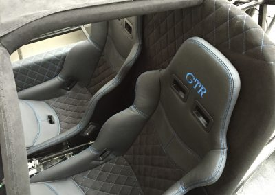 07-ultima-gtr-black-nappa-leather-blue-stitching-embroidered-logo