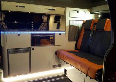 09-ford-custom-camper-leather-seats-bed-orange-black
