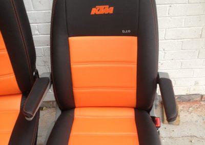 09-t5-leather-seats-black-orange-embroidered-logo