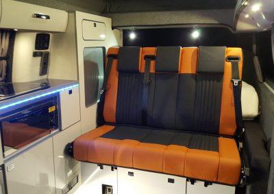 10-ford-custom-camper-leather-seats-bed-orange-black