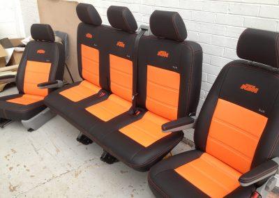 11-t5-leather-seats-black-orange-embroidered-logo