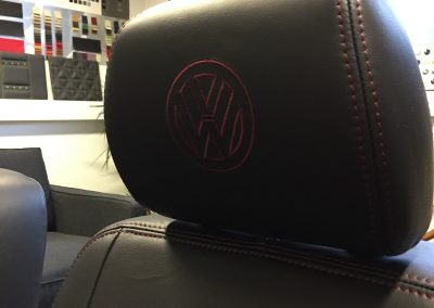 16-t5-leather-seats-purple-stitching-embroidered-logo