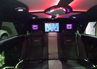2-limousine-interior-leather-seats-tv-led-ceiling